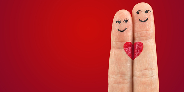 Zwei Finger bemalt als Liebespaar